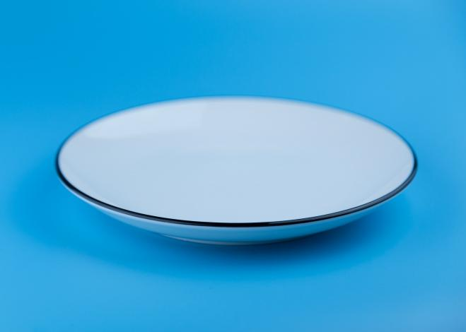 White plate with blue background