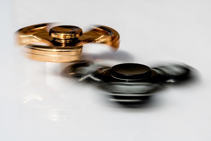 Black and gold fidget spinners spinning