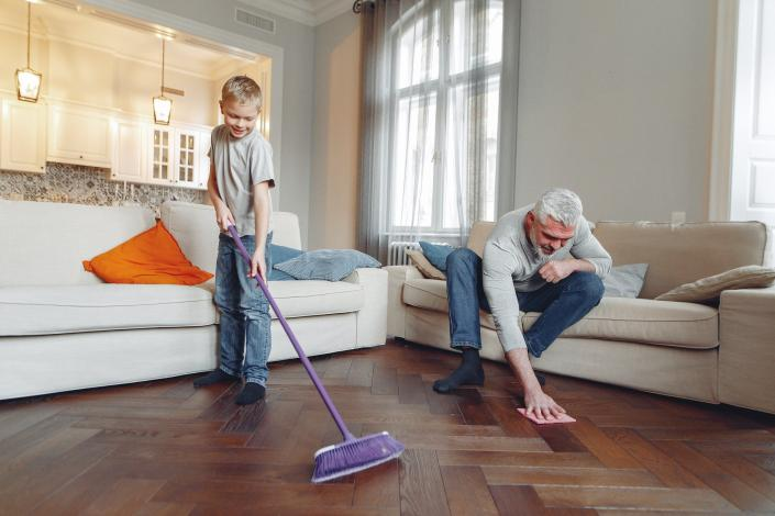 Photo of man and boy cleaning