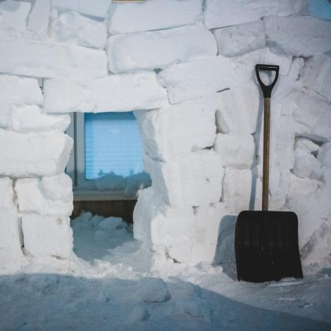 Snow blocks in front of house