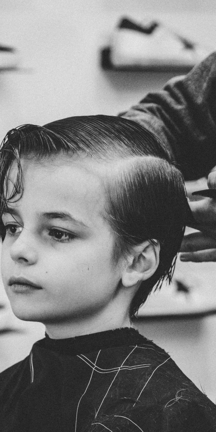 Boy having hair cut