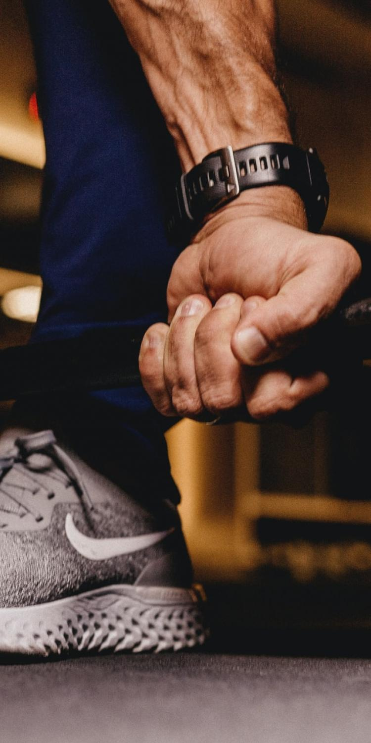 Person holding barbells